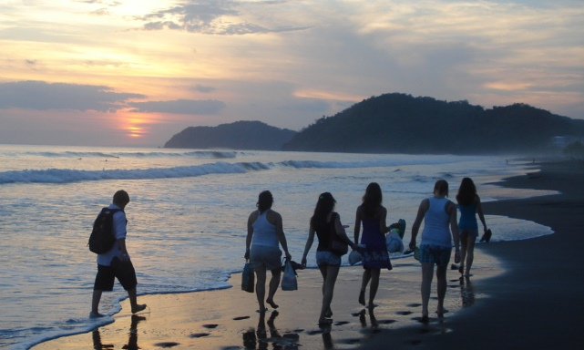 Jumpstreet Tours students enjoying the sunset in Jaco during their class trip to Costa Rica